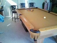 Connely pool table with a rare MGD pool table light.