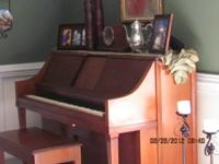 Cherry spinet player piano with bench and many player