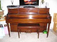 Cable brand, console piano with dark finish. All keys