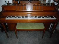 Koehler and Campbell console piano with matching bench.