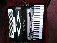 I HAVE THIS CONTELLO ACCORDION FOR SELL WITH CASE . WE