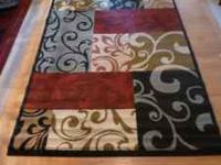 Contemporary area rug. Size is 5x7. Brand new. Still in
