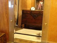 I have for sale a very contemporary hanging mirror. The