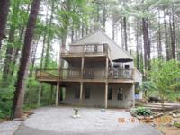 Contemporary 3 bedroom 2 bath home on a private 1 acre