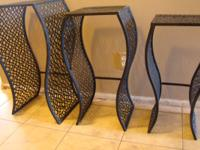 Beautiful contemporary set of 3 nesting tables. Will