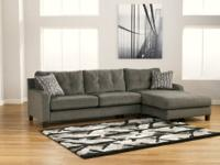 This sectional features plush boxed seat cushioning