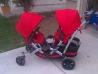 Selling a contour tandem stroller in red for $150 with