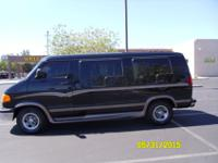 THIS IS A CUSTOM 8 PASSENGER VAN. WITH ONLY 72,800