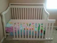 For sale is a white convertible crib; goes to a daybed