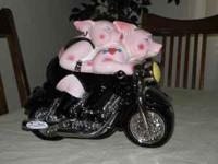 $20.00 Cookie Jar with Pigs riding a motorcyle. Too