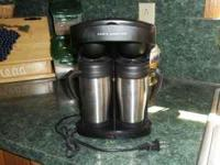 Cooks Essentials Coffee Maker with two travel mugs.