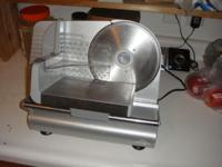 A cooks meat slicer in good used condition cutting