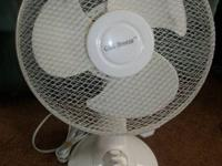 Features:  12 inch oscillating table fan  Adjustable