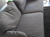 3-seater (could fit 4) grey Ikea couch for sale. Couch