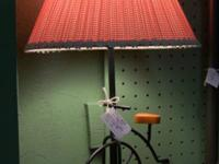 Unique lamp with a old-fashioned bicycle base. Great,