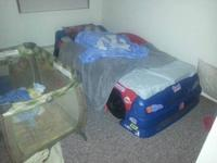 Moving must sell. Race Car Twin Bed Fits twin and crib