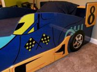 This Sporty Twin Race Bed is perfect for your child's