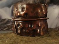 This is a hand forged fold formed cuff bracelet made