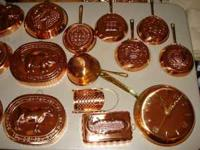 26 copper molds and a copper frying pan clock. This is