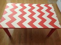 Hand-painted coral and white chevron coffee table. It