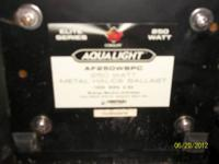 This is a used Coralife Metal Halide Light fixture. The
