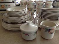 Corelle dinnerware: large plates, medium size plates,