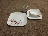 Perfect condition, set of 4.  All 8 plates, 4 bowls,
