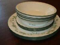 4 piece place setting. Good starter set. Green
