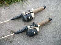 4 cork handle poles 2 have zebco 202 on them and 1 true