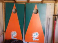 "I have a pair of ""Miami Dolphins"" corn hole boards for"
