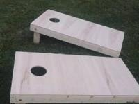 Corn hole set with fold in legs and deals with $75.