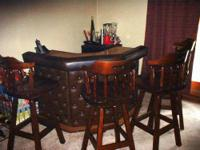 Here is a corner bar with 4 wood swivel bar chairs. The