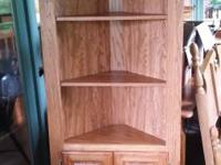 Very nice real wood corner curio.  And standing mirror.