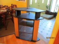 Am selling a corner entertainment center made of