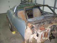 Body and frame from windshield back with some damage ,