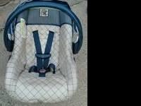 Cosco Travel System is jungle themed and neutral plaid