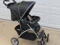 THIS IS A NICE SMALL COSCO JUVENILE STROLLER, FOLDS UP