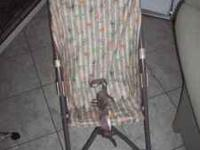 Cosco Stroller, simple store away. Has animal designs.