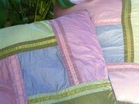 These stitched piecework pillows were created by The