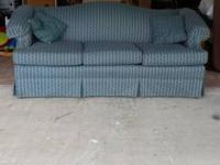 Blue couch. Has a 1 inch tear in one of the cushions