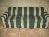 Green/ cream couch. It's a lazy boy with a hide-away