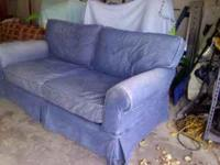 Couch with removable/washable denim cover. Cover is