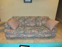 Colorful old couch. Willing to negotiate price. Used in