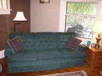 Green three person sofa. Very clean, no spills, pets,