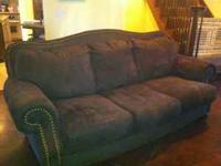 Brown Microfiber couch with nailhead trim. Non-smoking