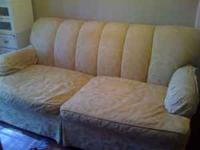 Nice comfortable cream couch. Asking $50.00. Call Tracy
