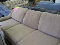 nice couch beige in color in great condition $69.95
