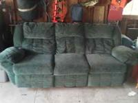 Green couch good condition. Recliners on both ends and