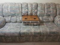 Couch with a hide-away bed and hidden tray with a