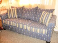 Blue couch with palm trees. Excellent shape Moving